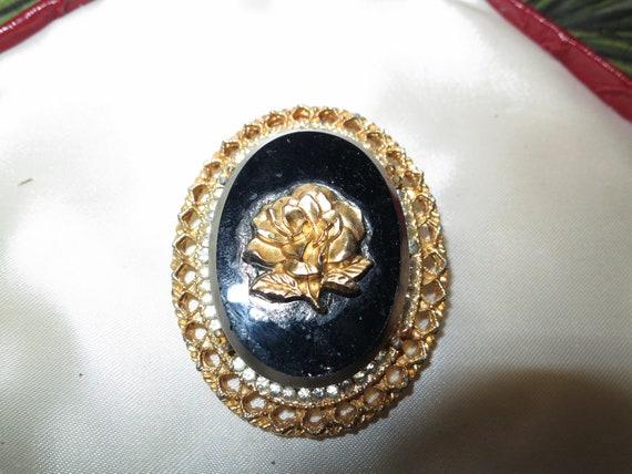 Wonderful vintage goldtone black glass rose cameo brooch or pendant