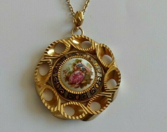 Vintage necklace with a pendant with courting couple on a ceramic base
