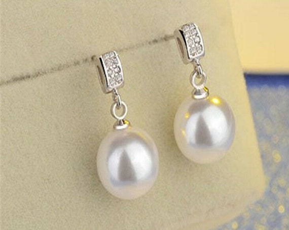 Beautiful 18 ct white gold filled 10 mm white high lustre seashell pearl stud earrings