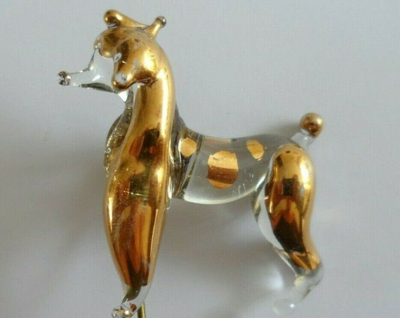 Vintage lapel pin brooch designed as a poodle dog clear and gold glass