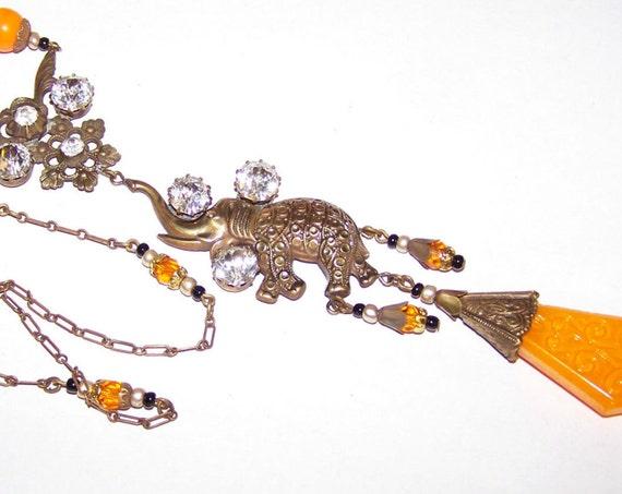 Lovely vintage 1930s Art Deco elephant necklace with large rhinestones and orange glass