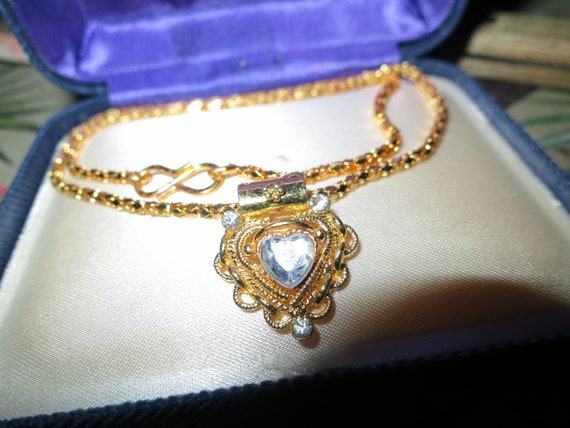 Beautiful vintage gold metal child necklace with rhinestone heart