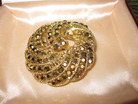 Large gold tone rivets heart and swirl embellishment