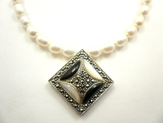Vintage sterling silver marcasite mother of pearl pendant