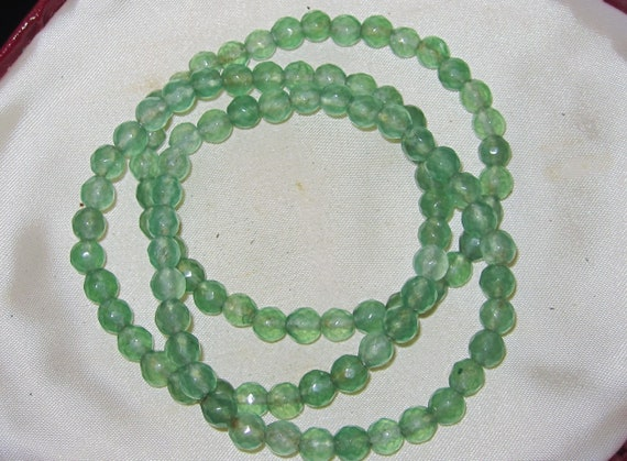 Lovely new natural faceted  6.5mm  jade bracelet
