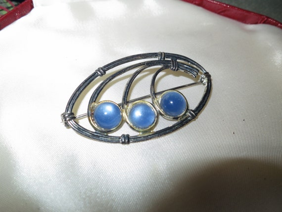Wonderful vintage sterling silver Nouveau design brooch with blue opal glass stones