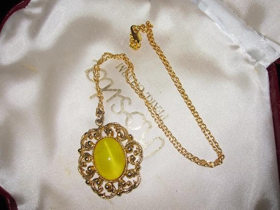 Lovely vintage goldtone  framed yellow satin glass pendant necklace