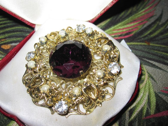 Beautiful vintage Large  Ornate Filigree Purple Rhinestone brooch