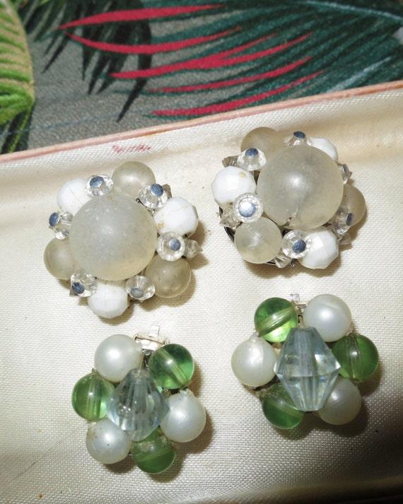 2 pairs of vintage 1950s clip on cluster beaded earrings.
