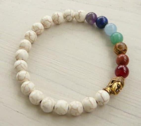 Lovely gold metal Buddha  7 chakra 8mm white turquoise bracelet  unisex