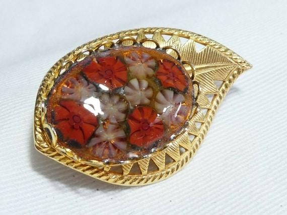 Lovely vintage millefiori Goldtone tiny flower encased in Glass  Leaf  brooch