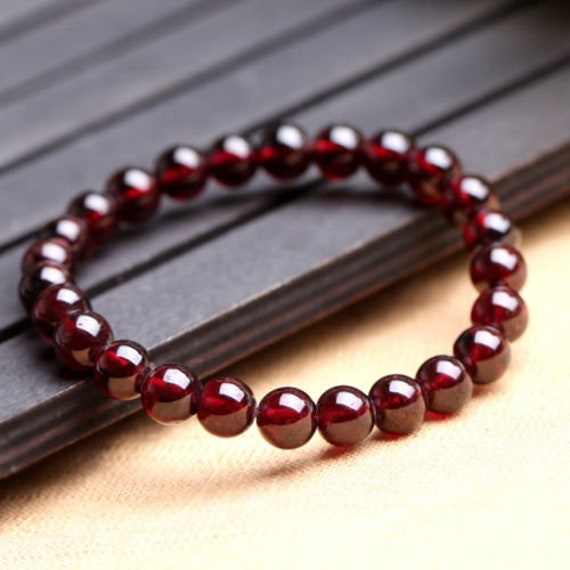 Lovely new genuine garnet bracelet 6mm stones