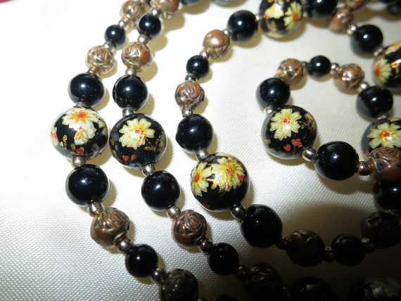 Beautiful vintage black glass with painted yellow flower beaded necklace