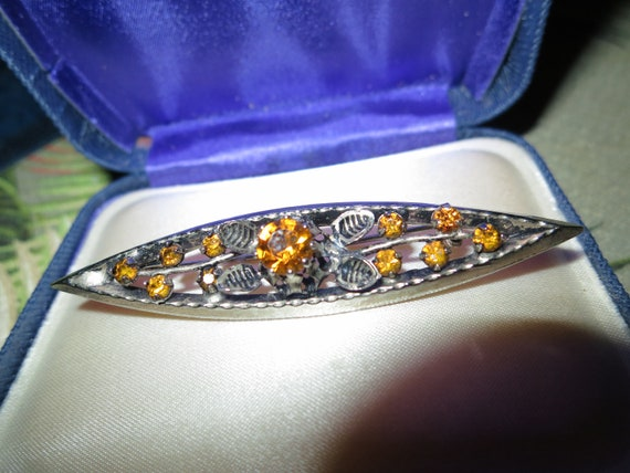 Vintage goldtone faceted amber glass floral bar brooch