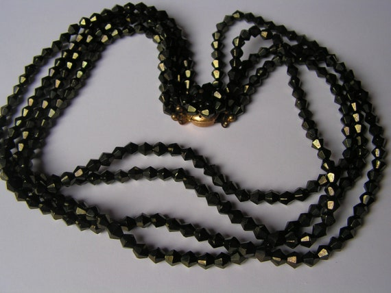 Fabulous vintage 4 strand black glass with gold wash necklace
