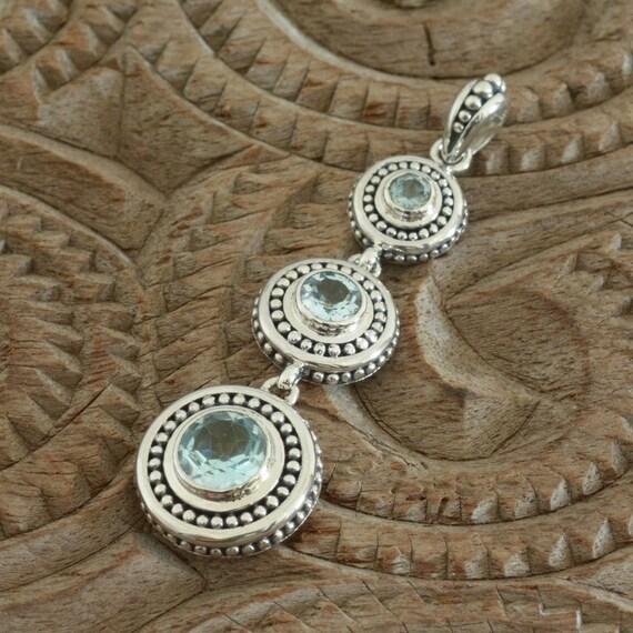 Lovely new sterling silver Pendant Genuine Sky Blue Topaz