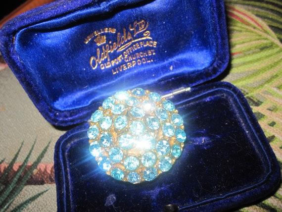 Beautiful vintage Deco goldtone blue glass circular brooch