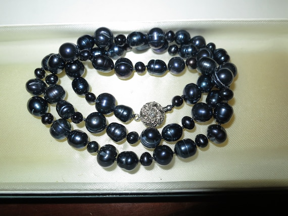 Attractive black cultured freshwater pearl necklace 25 inches silver plated clasp