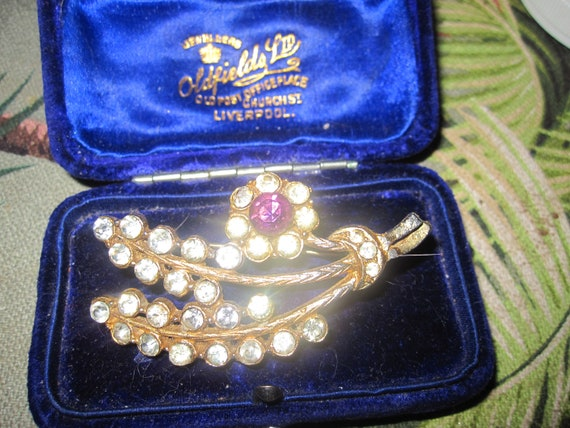 Delightful  Vintage 1950s gold plated clear and purple rhinestone floral brooch