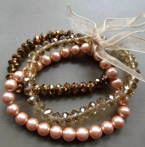 Beautiful vintage set of 3 peach copper tone fx pearl glass bead stretch bracelets