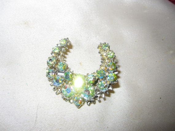Lovely vintage goldtone green  aurora borealis crescent brooch