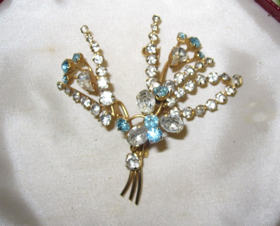 Lovely large vintage goldtone clear and aqua rhinestone Floral Brooch