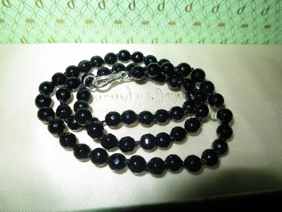 Lovely 6mm faceted natural black onyx knotted necklace sterling silver clasp