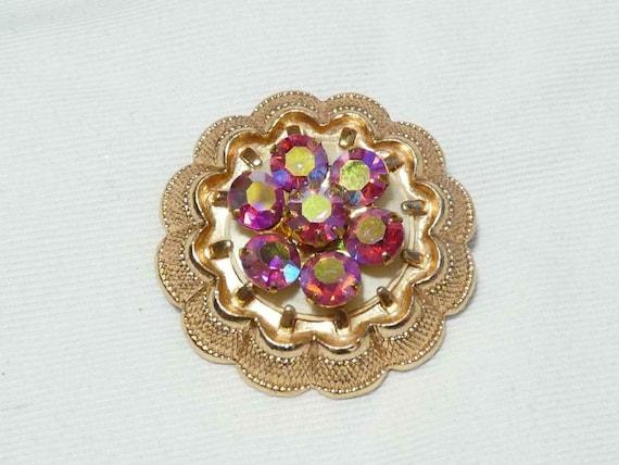 Lovely vintage  Goldtone Metal & Pink Aurora Borealis Rhinestone brooch