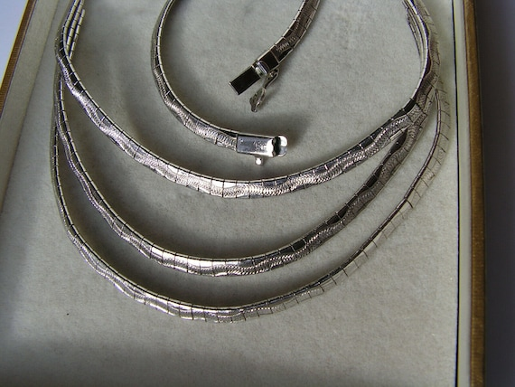 Lovely vintage silver plated etched 3 strand necklace