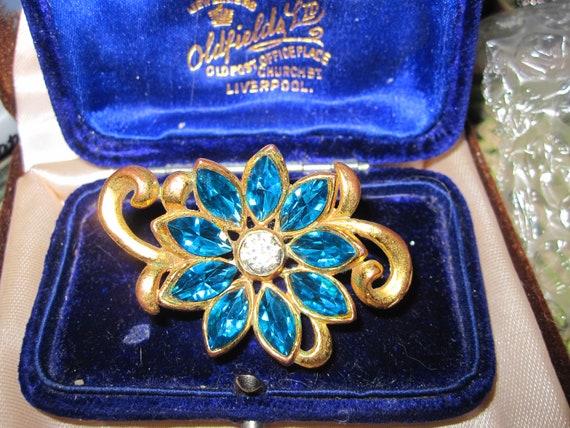 Beautiful vintage goldplated teal blue glass flower brooch