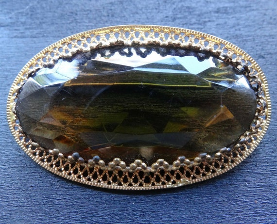 Lovely vintage large amber green glass rhinestone gold tone brooch