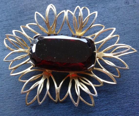 Lovely vintage faceted garnet red open back gold tone brooch