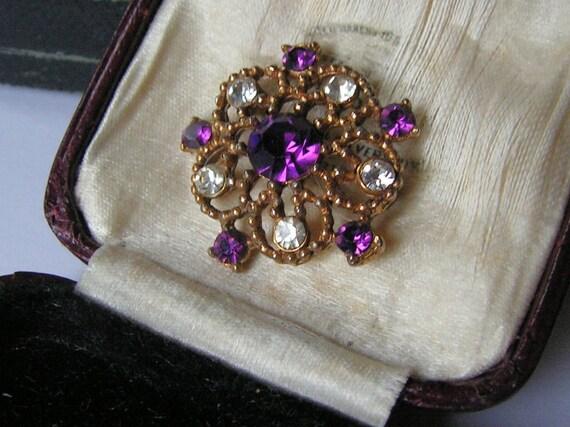 Wonderful Vintage goldtone openwork amethyst glass brooch