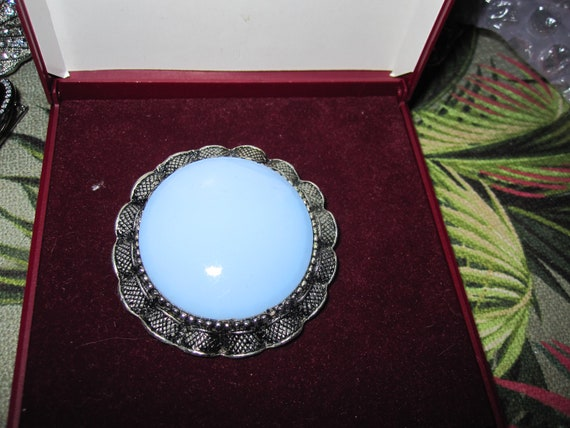 Lovely vintage  Ribbon Style Edge Framed & Pale Blue Glass brooch