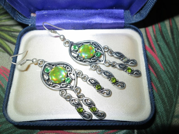 Lovely vintage silvertone opal lucite and turquoise glass stones.  2.3 inches