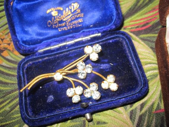 Wonderful vintage goldtone clear rhinestone floral brooch