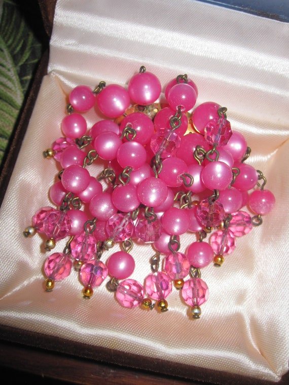 Lovely vintage pink lucite and pink aurora borealis glass cascade brooch