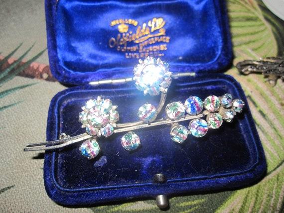 Wonderful vintage silvertone sparkly iris rainbow glass floral brooch