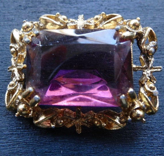 Lovely vintage faceted purple glass open back gold tone brooch