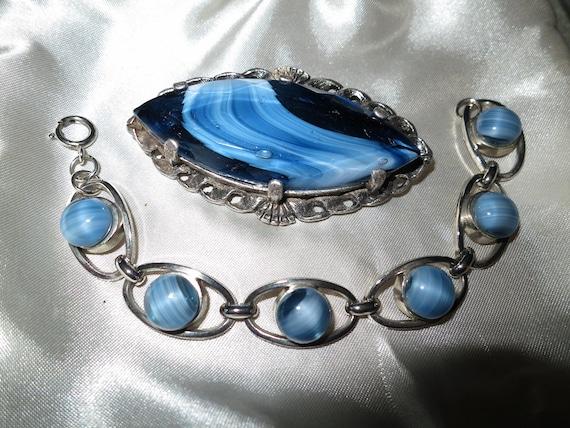 Lovely vintage set of silvertone blue banded glass bracelet and large brooch