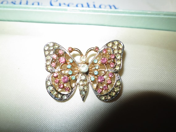 Lovely vintage CORO tagged rhinestone butterfly brooch and clip on earrings