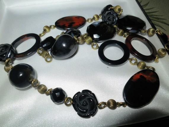 Stunning vintage goldtone carved black onyx tortoiseshell glass long necklace