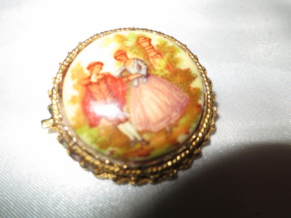 Lovely vintage Fragonard style romantic scene ceramic brooch