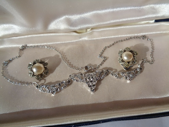 Classic vintage set of silvertone marcasite necklace and clip on earrings