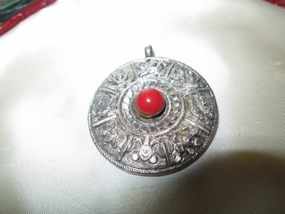 Beautiful vintage decorative cared pendant with real coral stone