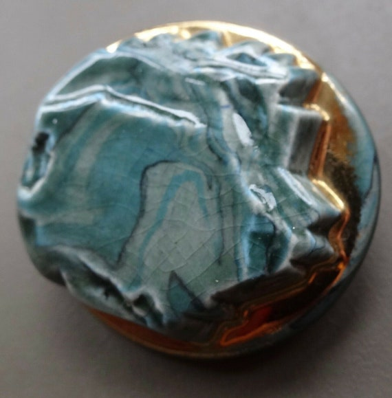 Beautiful vintage signed Jersey Pottery teal blue gilt gold ceramic brooch