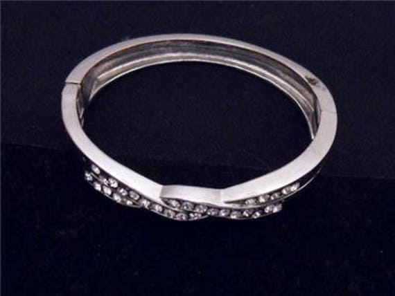 Attractive Vintage Silvertone and glass Crystal Studded Cross Over Bangle