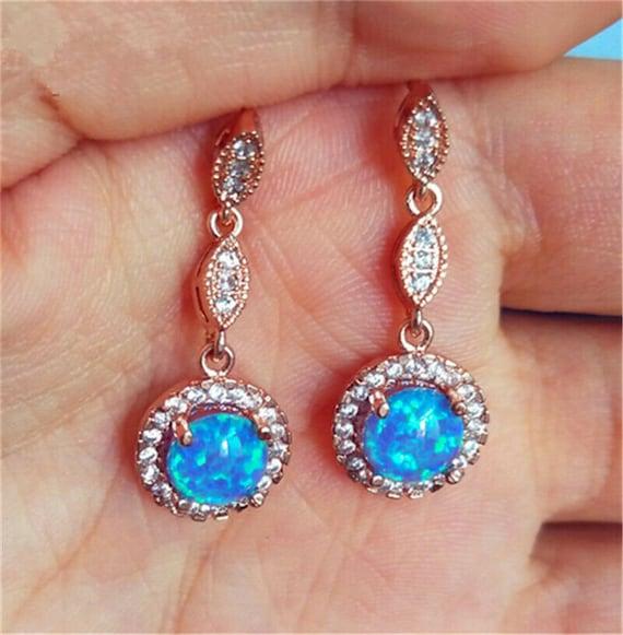 Beautiful 18 ct rose gold filled 6 mm blue fire opal stud earrings
