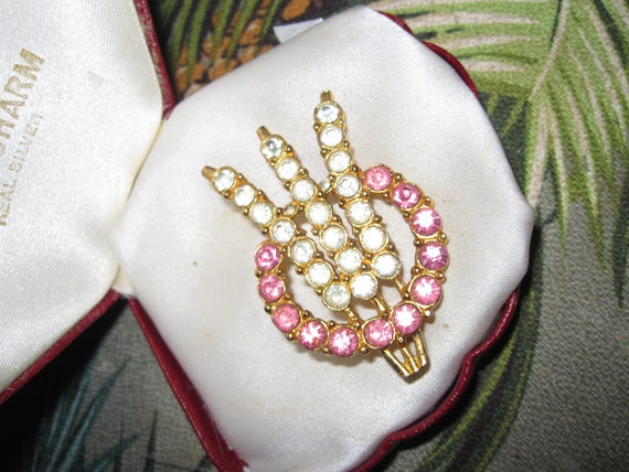 Lovely vintage goldtone pink and clear rhinestone brooch