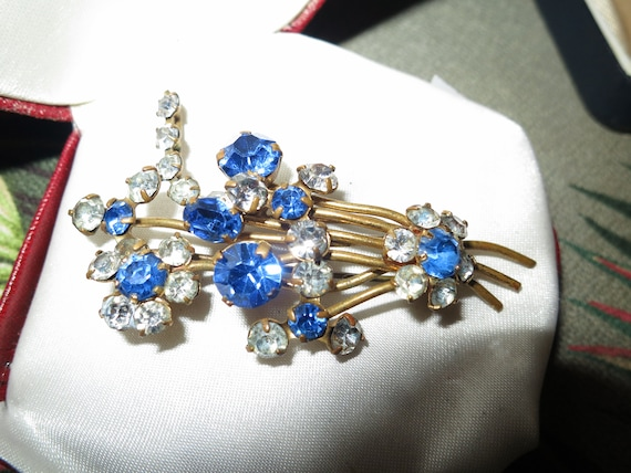 Beautiful vintage gold metal clear and blue glass floral spray brooch